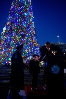 Capitol Police Chief Kim Dine, Giovanni Philip Gaynor, 6, of Colville, Wash., and Boehner are pictured shortly after they lit the Capitol Christmas Tree on the west front. The 88-foot Engelmann spruce was harvested from the Colville National Forest in Washington state. (Tom Williams/CQ Roll Call)