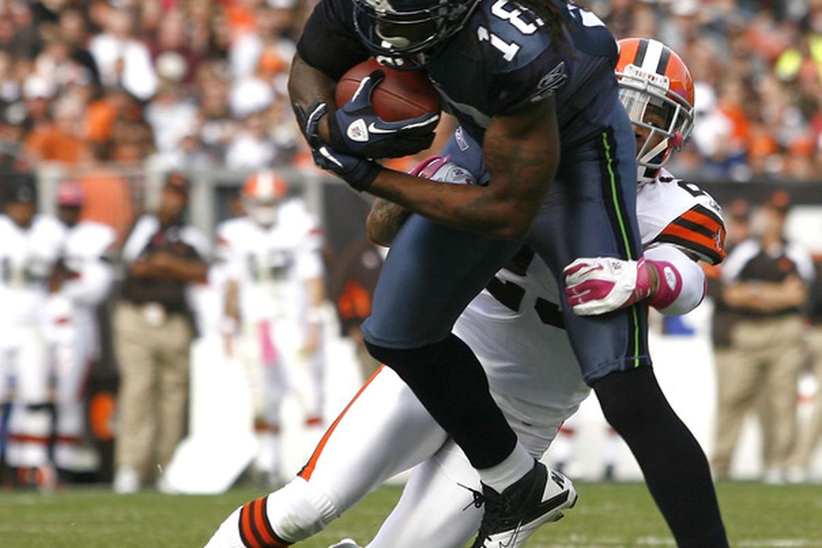 hight resolution of cleveland oh october 23 defensive back joe haden 23 of the cleveland browns tackles wide receiver sidney rice 18 the seattle seahawks at cleveland