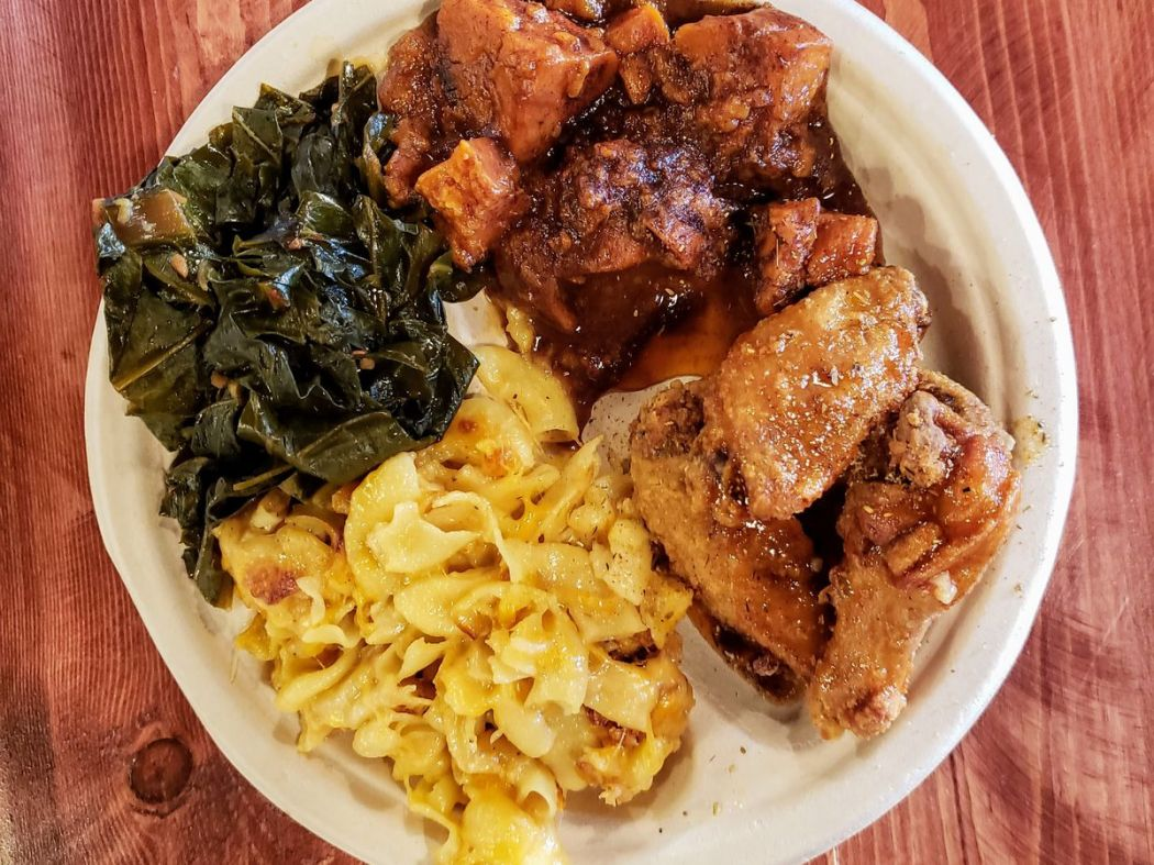 Comfort L.A. platter with mac and cheese, chicken wings, and sweet potatoes