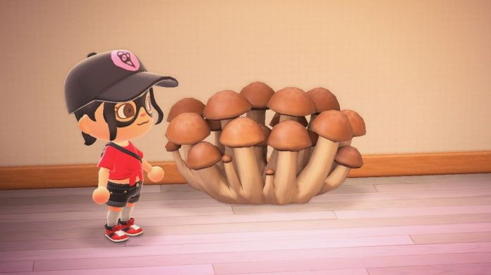 An Animal Crossing character stands next to a large cluster of mushrooms