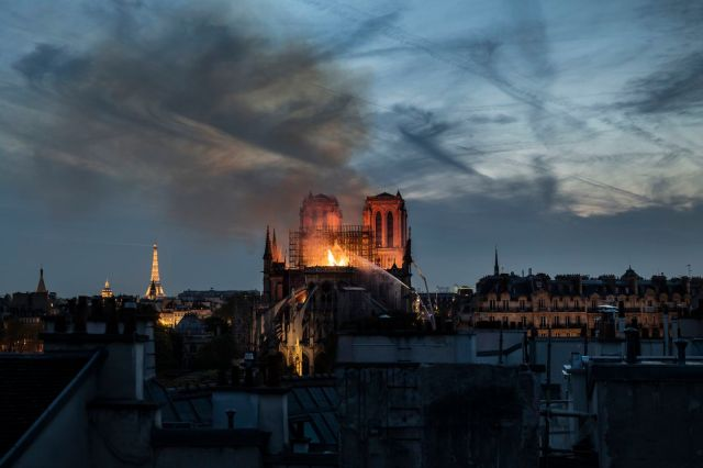 Flames and smoke are seen billowing from the roof at Notre-Dame Cathedral on April 15, 2019 in Paris, France.