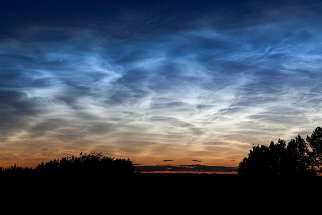 Noctilucent clouds spotted just before midnight in 2011 near Edmonton, Canada.