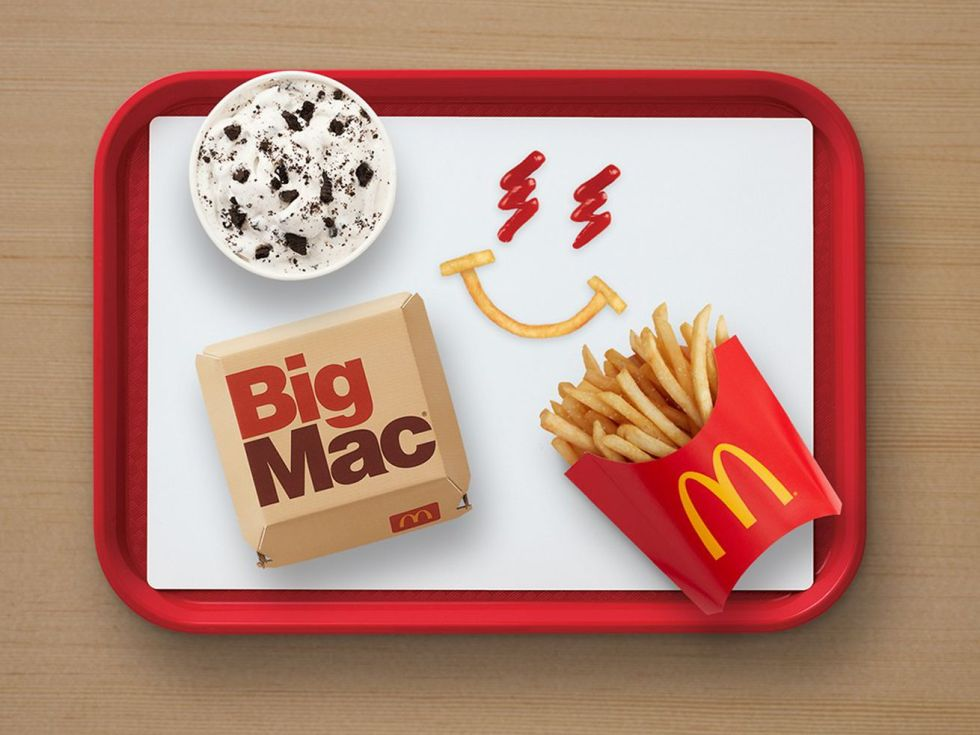 McDonald's Big Mac, McFlurry, fries, and J Balvin smiley face on a tray.