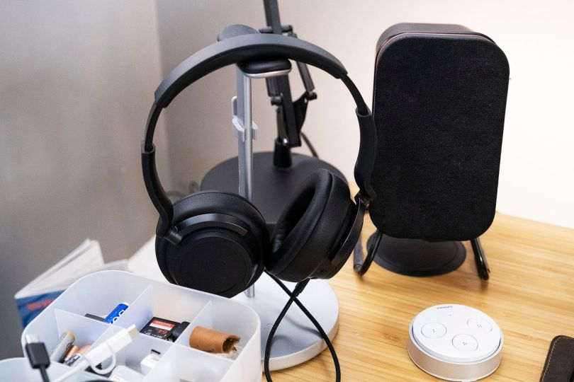 A set of Microsoft Surface Headphones 2 next to a long-discontinued speaker from Audyssey.