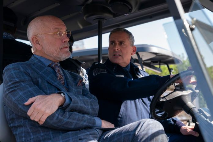 General Naird (Steve Carell) and Dr. Mallory (John Malkovitch) drive a golf cart