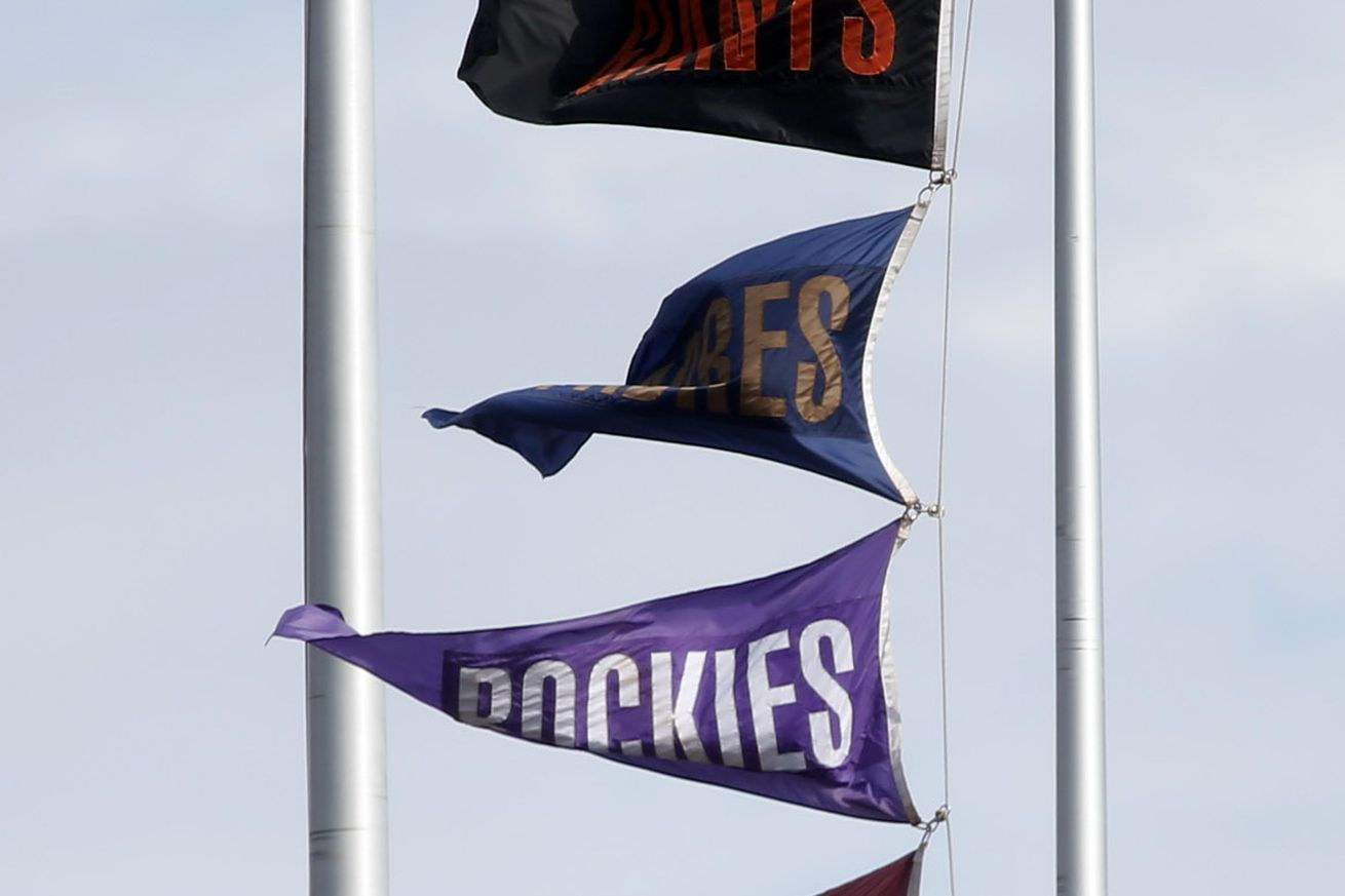 The flags at AT&T Park indicate the final regular season standings in the National League West after the San Francisco Giants defeated the San Diego Padres in San Francisco, Calif., on Sunday, Sept. 28, 2014. (Karl Mondon/Bay Area News Group