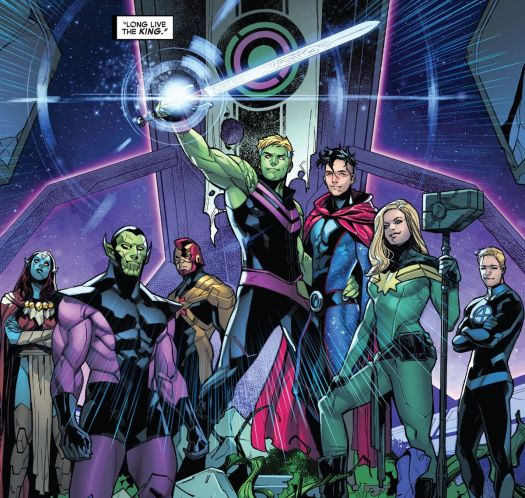 Teddy (Hulkling), emperor of the Kree/Skrull alliance, lifts his cosmic sword in triumph, flanked by his husband Billy (Wiccan) an Captain Marvel, the Human Torch, and more, in Empyre #6, Marvel Comics (2020).