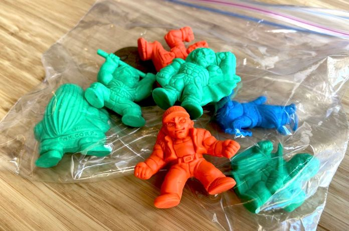 green, red, and blue Fatal Fury figurines in a Ziploc bag
