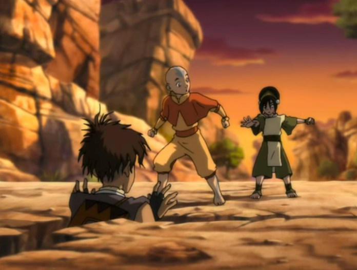Aang and Toph find Sokka stuck in a hole, in Avatar: The Last Airbender.