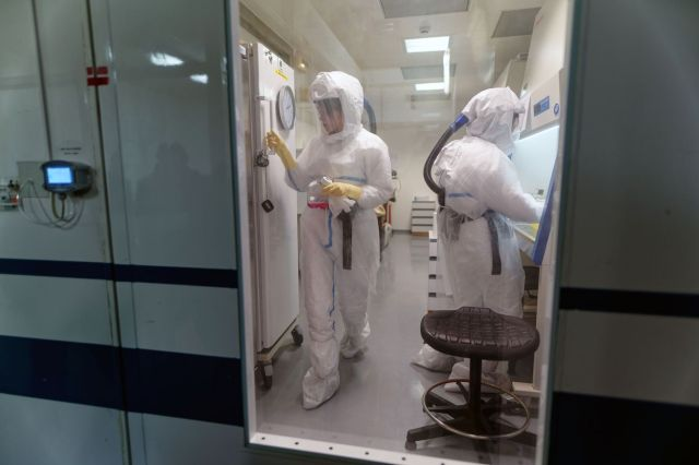 Laboratory Staff At The Pasteur Institute Work On The Coronavirus