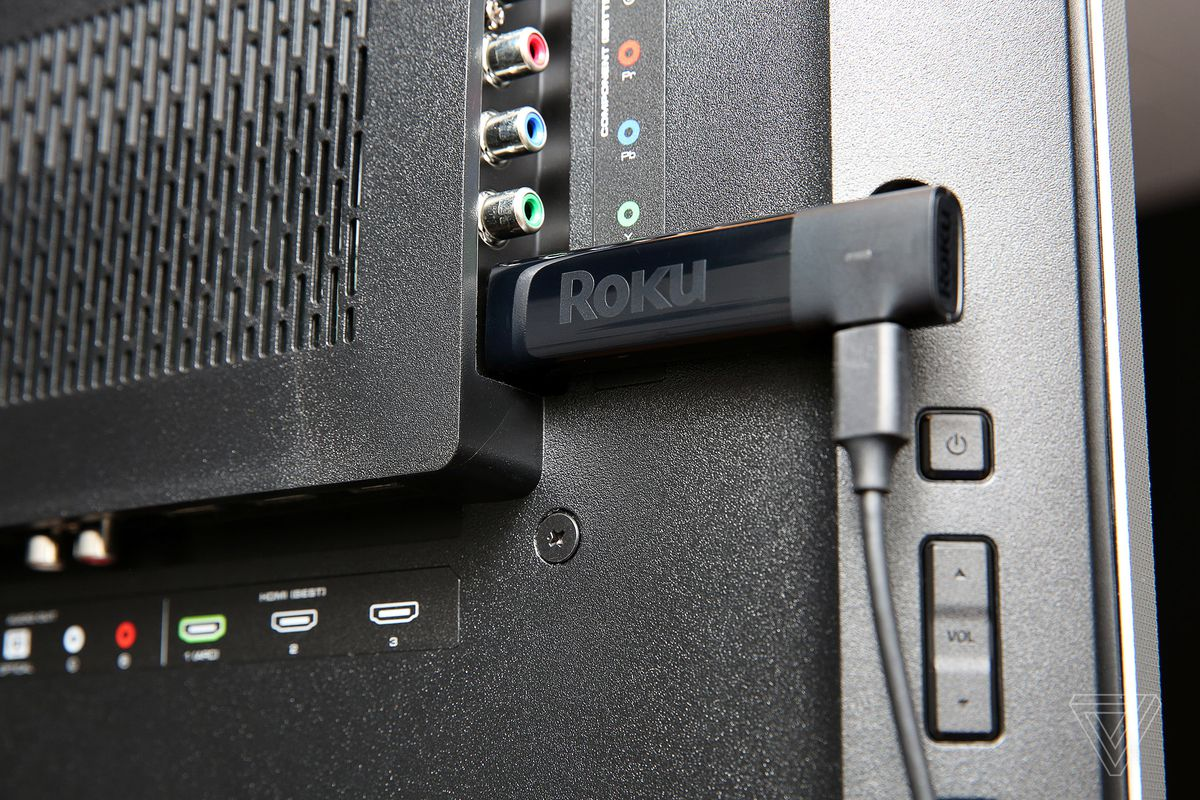 An image of the Roku Streaming Stick Plus, the best streaming device for ease of use, plugged into a TV.