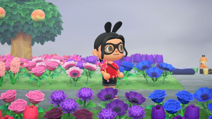 An Animal Crossing villager holding a pink butterfly wand in a field of flowers