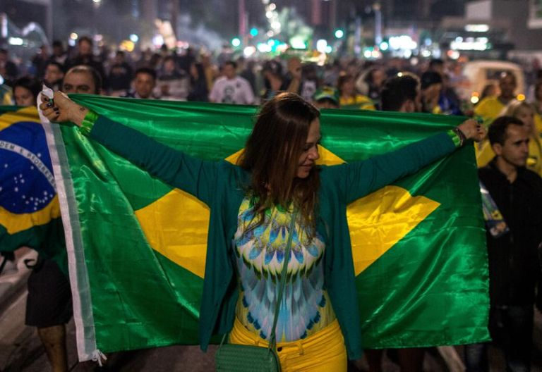 Supporters of right-wing candidate Jair Bolsonaro celebrate victory in the presidential elections on October 28, 2018 in Sao Paulo, Brazil.