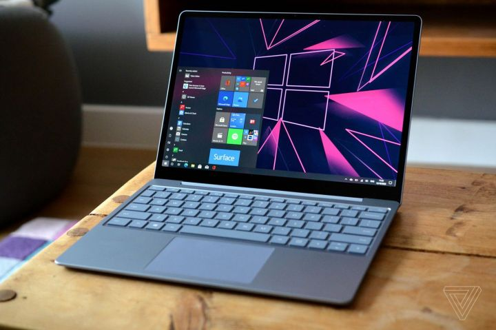 The Surface Laptop Go on a table angled slightly to the left.