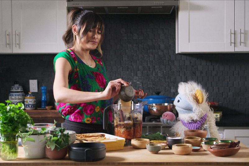 Bricia Lopez cooking in her kitchen with Waffles and Mochi.