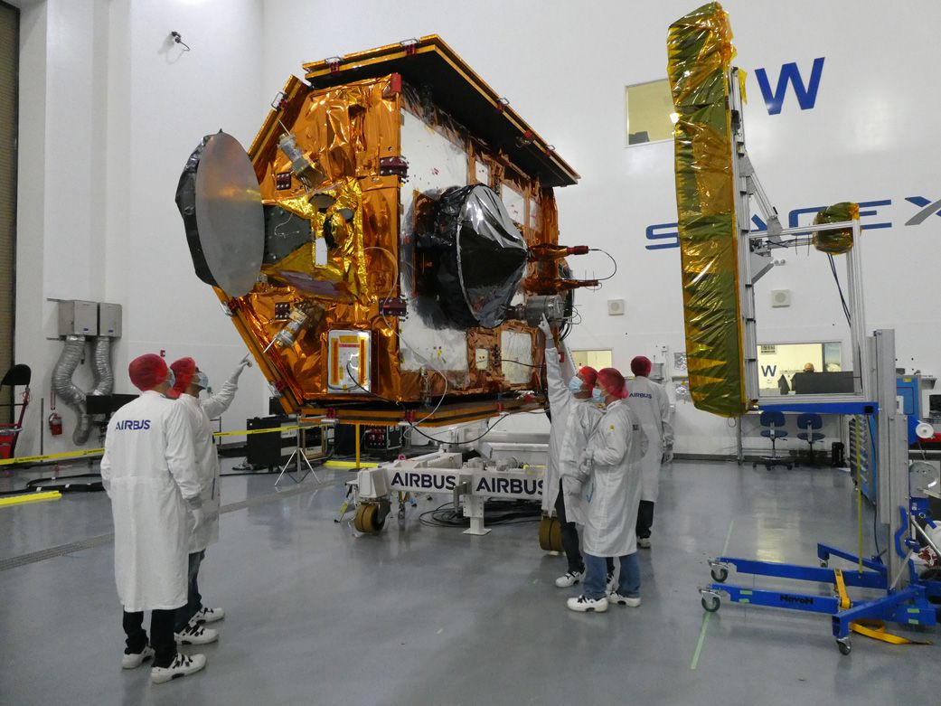 Sentinel-6 Michael Freilich team members from European Space Agency pose with the spacecraft during processing.