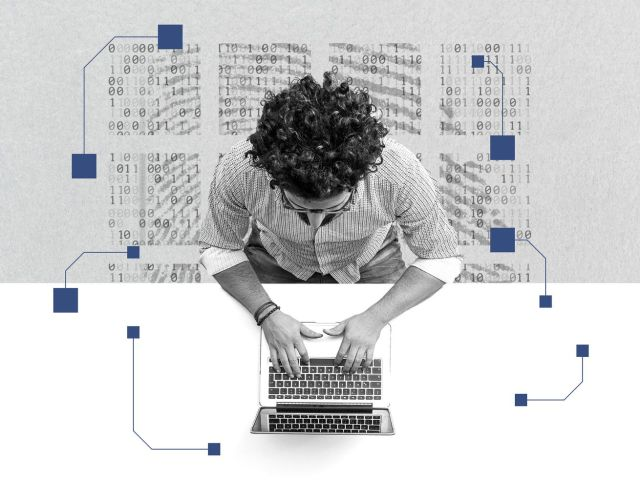 An overhead view of a man on a laptop. There's binary code in the background.