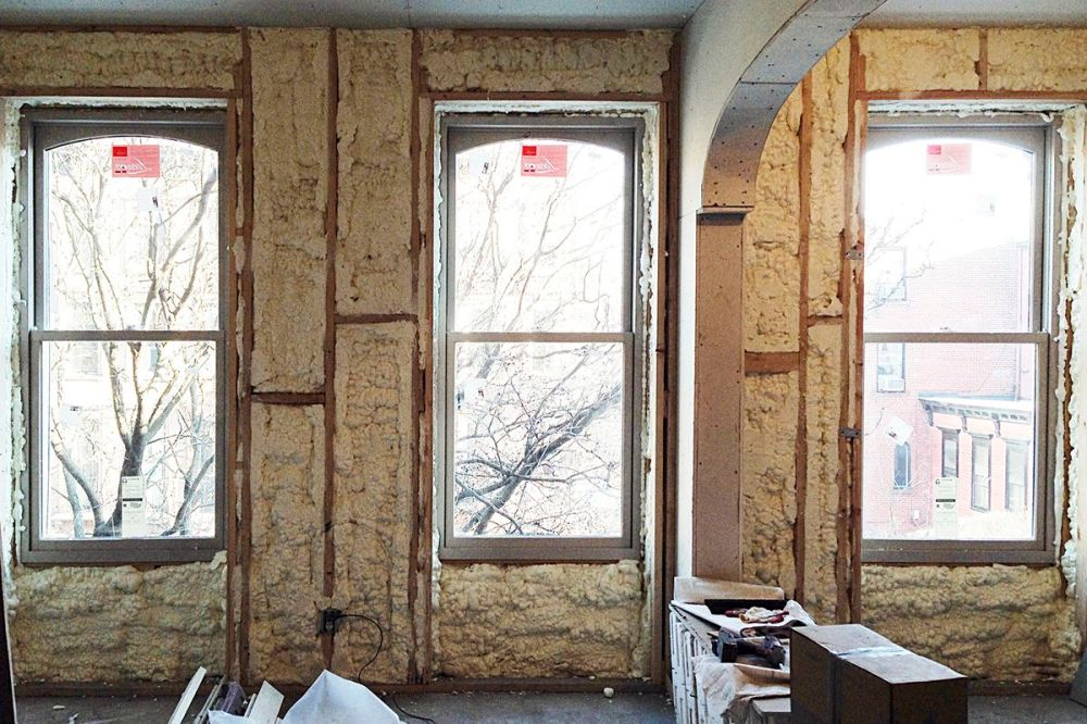 medium resolution of new loewen windows being installed during the systems phase of brent allen buck s brownstone renovation