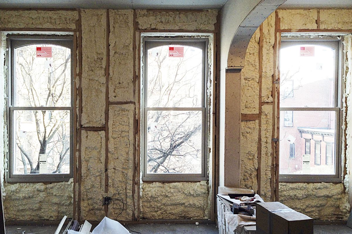 hight resolution of new loewen windows being installed during the systems phase of brent allen buck s brownstone renovation