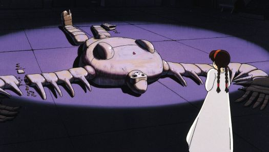 A girl in a loose white nightgown and long brown braids stairs at a broken robot sprawled on its back in Castle in the Sky.