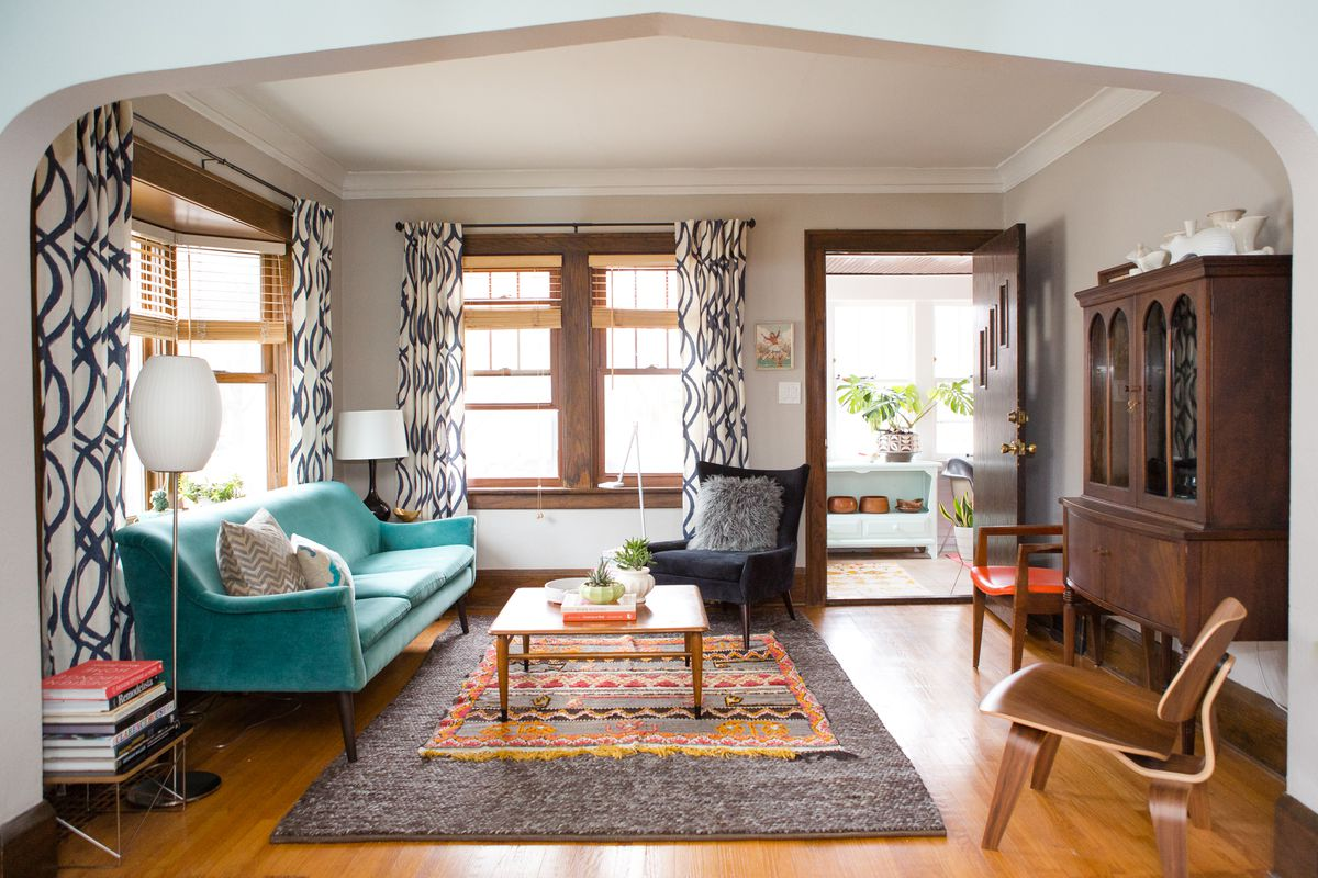 rugs in living room for small space rug ideas and tips how to choose the right one curbed this cozy minneapolis bungalow shows do layering a neutral base with smaller accent piece on top photo by wing ta
