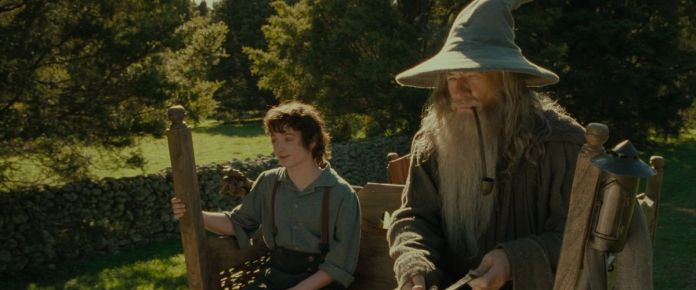 frodo and gandalf ride on a car in fellowship of the rings the lord of the rings