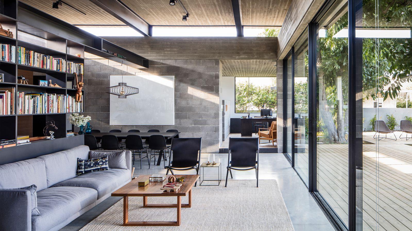 Concrete house offers indooroutdoor living among fruit