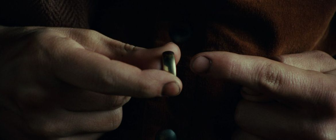 Frodo points his finger towards the opening of the Ring in The Fellowship of the Ring.