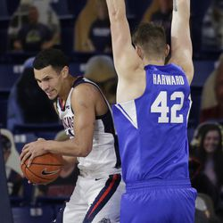 Gonzaga guard Jalen Suggs, left, catches a rebound next to BYU center Richard Harward during the first half of an NCAA college basketball game in Spokane, Wash. On Thursday, Jan.7, 2021.