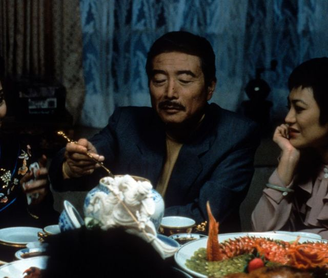 Sihung Lung Serving Himself At The Table In A Scene From The Film Eat Drink