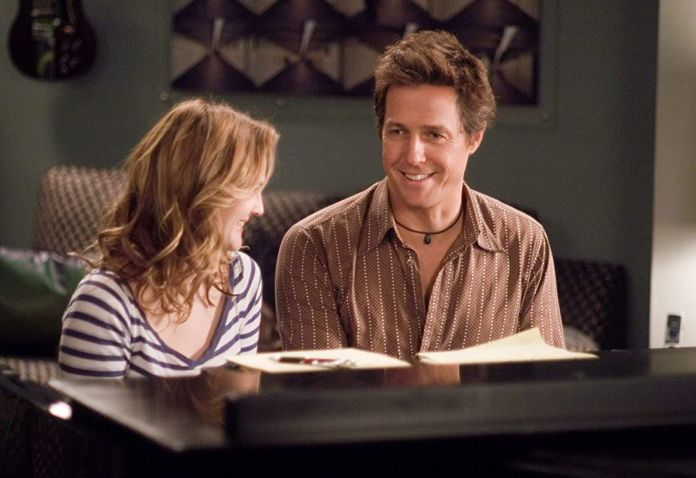 music and lyrics: hugh grant and drew barrymore sit at a piano and smile