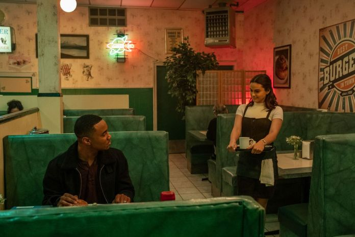 a young couple in a diner