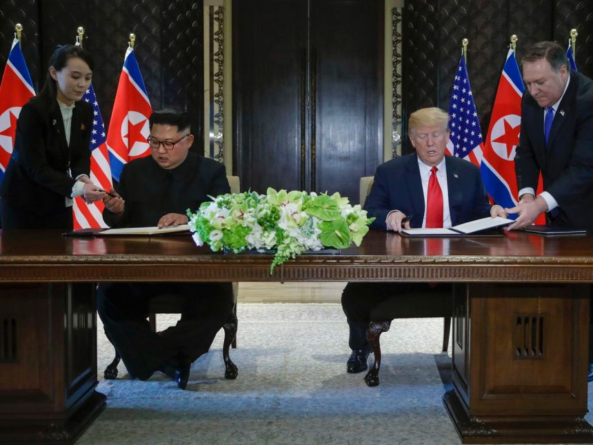 President Donald Trump and North Korean leader Kim Jong Un prepare to sign a document at a ceremony marking the end of their historic nuclear summit at the Capella hotel on Singapore's Sentosa island on Tuesday, June 12, 2018.