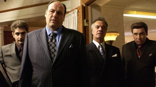 Tony Soprano and co. standing in suits