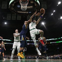 Boston Celtics' Jayson Tatum tries to shoot past Utah Jazz's Rudy Gobert during the fourth quarter of an NBA basketball game Friday, March 6, 2020, in Boston.