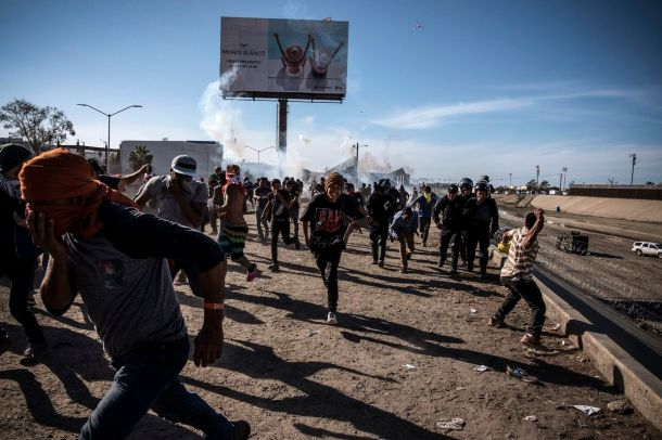 US officials closed the San Ysidro crossing point in southern California on Sunday after hundreds of migrants tried to breach a fence from Tijuana.