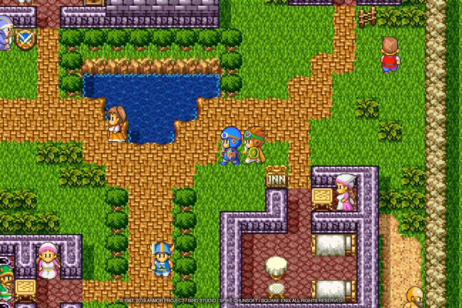 The Hero and his party member stroll down a path in Dragon Quest 2