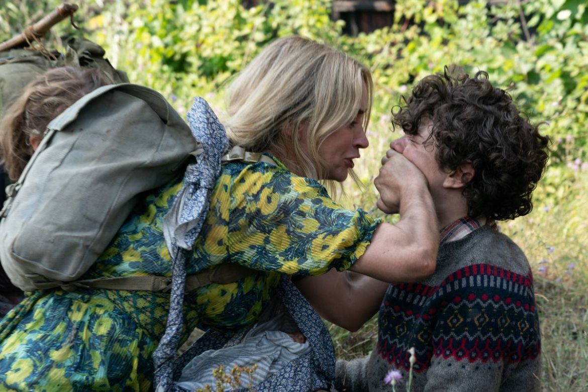 Evelyn (Emily Blunt) puts her hand over Marcus' (Noah Jupe) mouth in A Quiet Place Part II