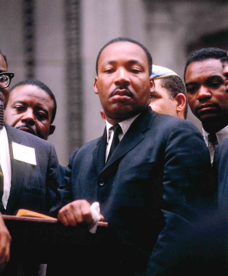 Dr. Martin Luther King, Jr. in front of City Hall, July 26, 1965.
