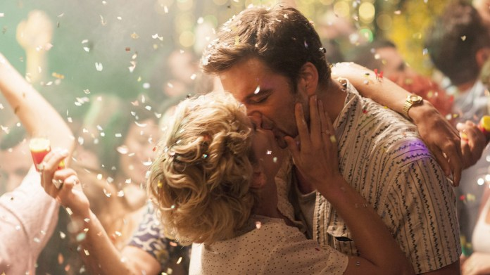 Sebastian Stan and Denise Gough embrace amid a shower of confetti in the romantic drama Monday