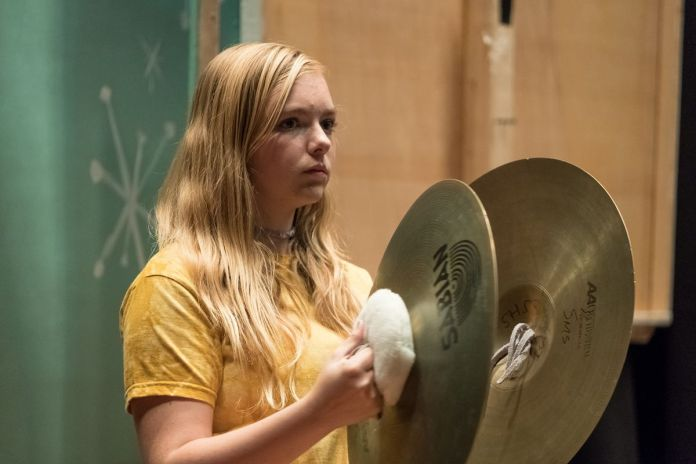 a blonde teenage girl holding two cymbals in Eighth Grade