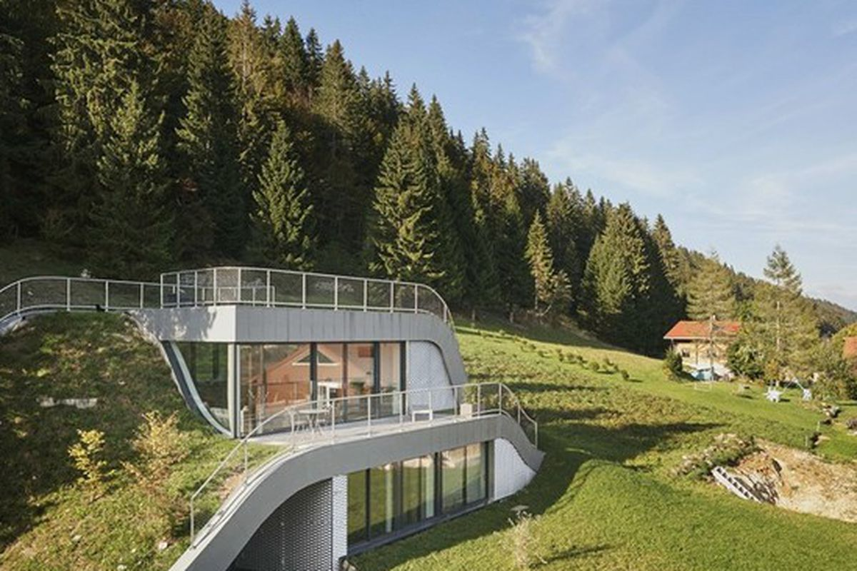 Swooping French Home Is Partially Built Into a Hillside