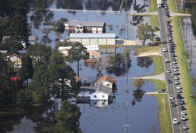 Flood waters are seen surrounding homes after heavy rains from Hurricane Florence on September 20, 2018 in Lumberton, North Carolina. The rainfall from Hurricane Florence was a 1,000-year event.