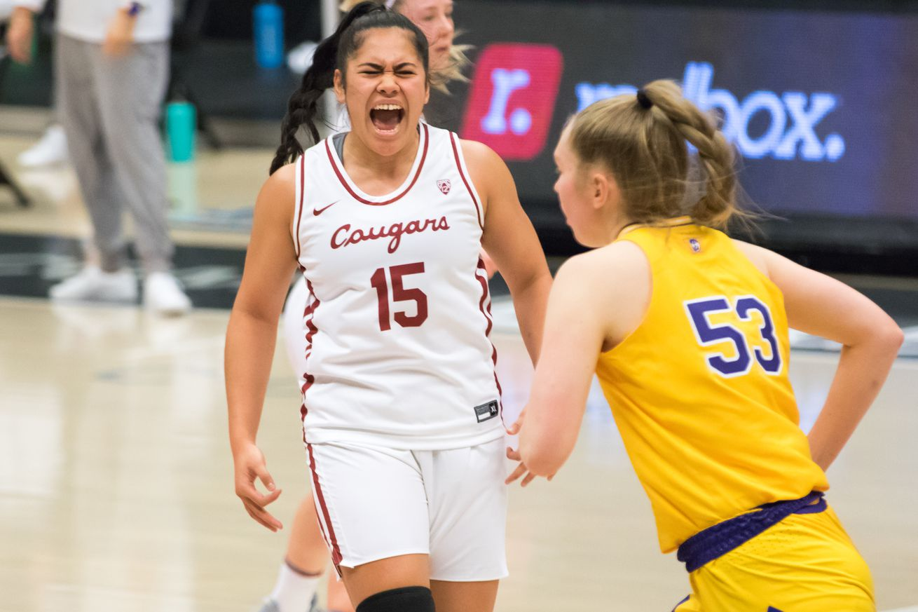 PULLMAN, WA - FEBRUARY 28: Washington State forward Ula Motuga (15) yells after hitting a three point shot during the second half of a Boeing Apple Cup Series matchup between the Washington Huskies and the Washington State Cougars on February 28, 2021, at Beasley Coliseum in Pullman, WA.