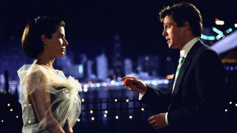 Hugh Grant and Sandra Bullock chat on the Brooklyn Bridge