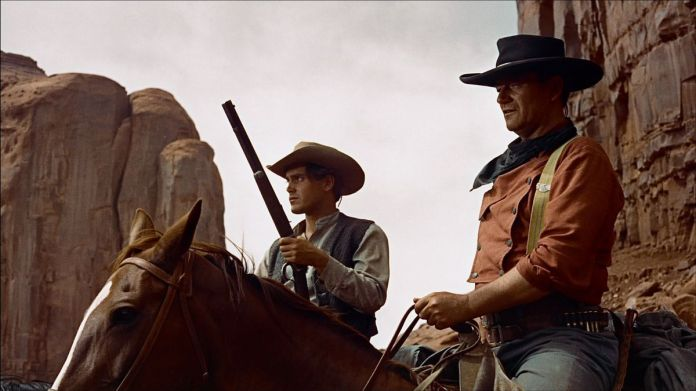 john wayne on a horse in the searchers