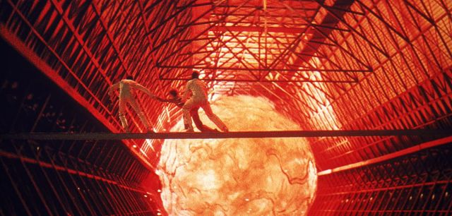 Workers run away from a molten orb in a screenshot from The Black Hole