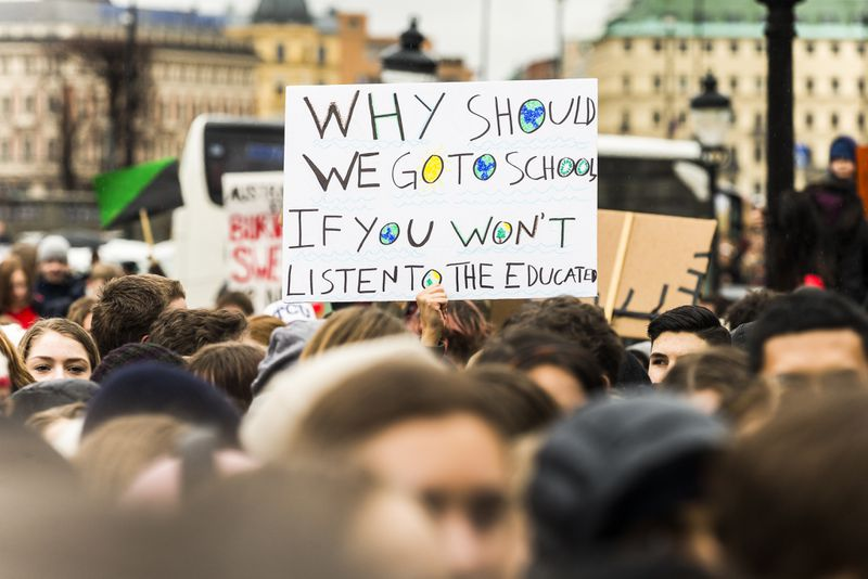 Students participate in a strike outside of the Swedish parliament house, Riksdagen, in order to raise awareness for global climate change on March 15, 2019 in Stockholm, Sweden.