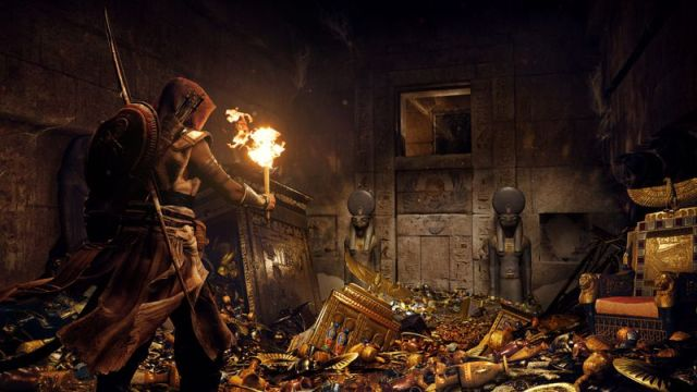 Bayek raids a treasure-filled tomb in Assassin's Creed Origins
