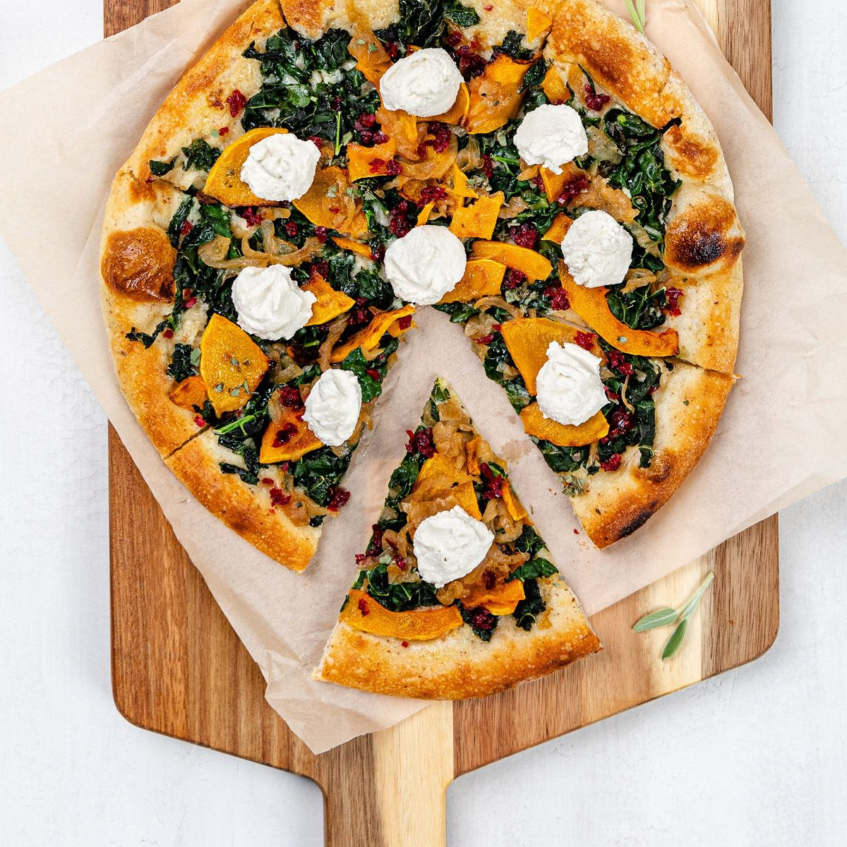 Vegan butternut squash pizza, which can come on a gluten-free crust, topped with ricotta and kale from True Food Kitchen.